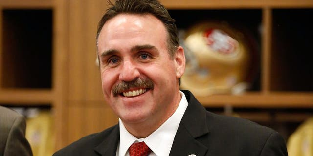 Jan 15, 2015; Santa Clara, CA, USA; San Francisco 49ers head coach Jim Tomsula poses for a photo in the locker room after a press conference for his introduction as head coach at Levi's Stadium Auditorium. Mandatory Credit: Kelley L Cox-USA TODAY Sports