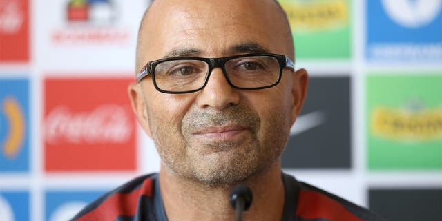 """Chilean national football team, Argentinian Jorge Sampaoli, gestures as he speaks during a press conference in Santiago, Chile, on January 13, 2016. Chile coach Jorge Sampoali appears on the verge of quitting six months after guiding La Roja to the Copa America, with the Argentine claiming he is being held """"hostage"""" by the federation. AFP PHOTO/CLAUDIO REYES / AFP / Claudio Reyes (Photo credit should read CLAUDIO REYES/AFP/Getty Images)"""