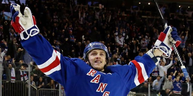 NEW YORK, NY - JANUARY 20: Carl Hagelin #62 of the New York Rangers celebrates his game winning goal against Craig Anderson #41 of the Ottawa Senators to defeat the Ottawa Senators in overtime in their game at Madison Square Garden on January 20, 2015 in New York City. (Photo by Bruce Bennett/Getty Images)
