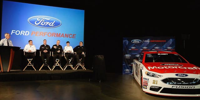 CHARLOTTE, NC - JANUARY 20: The Wood Brother's race Team talkswithnreporters after revealing the new Ford Fusion number 21 car during the second day of the NASCAR 2016 Charlotte Motor Speedway Media Tour on January 20, 2016 in Charlotte, North Carolina. (Photo by Bob Leverone/NASCAR via Getty Images)