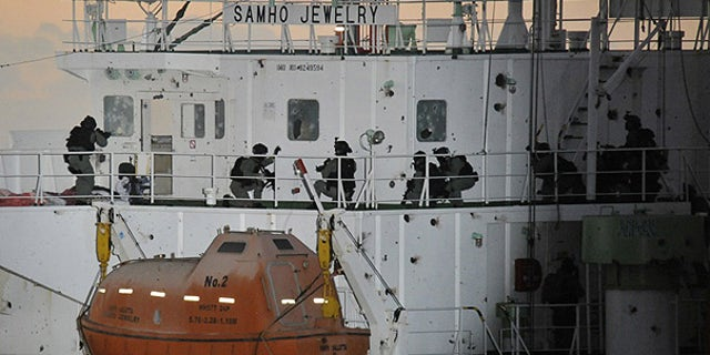 Jan. 21: South Korean naval special forces prepare to rescue crew members from Somali pirates on cargo ship Samho Jewelry in the Arabian Sea.