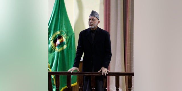 """Afghan President Hamid Karzai addesses military officers in Kabul, Afghanistan, Saturday, Feb. 16, 2013. Afghan President Hamid Karzai said Saturday he plans to issue a decree banning Afghan security forces from asking international troops to carry out airstrikes under ``any circumstances."""" The announcement came amid anger over a joint Afghan-NATO operation this week that Afghan officials said killed 10 civilians, including women and children, in northeast Kunar province.(AP Photo/Ahmad Jamshid)"""