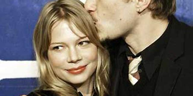 Australian actor Heath Ledger kisses girlfriend Michelle Williams during arrivals at the 15th annual Gotham Awards in New York, on Nov. 30, 2005.