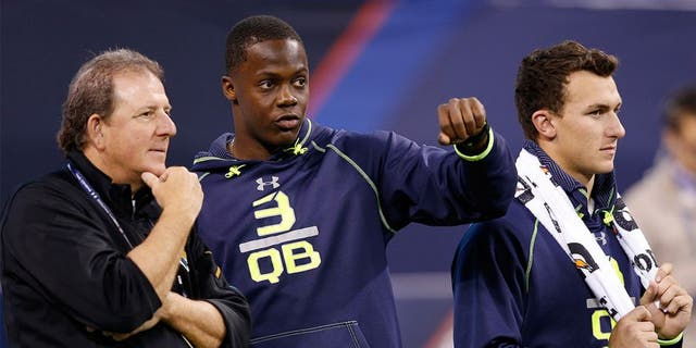 INDIANAPOLIS, IN - FEBRUARY 23: Former Louisville quarterback Teddy Bridgewater (center) and former Texas A&M quarterback Johnny Manziel stand alongside Jacksonville Jaguars assistant Frank Scelfo during the 2014 NFL Combine at Lucas Oil Stadium on February 23, 2014 in Indianapolis, Indiana. (Photo by Joe Robbins/Getty Images)