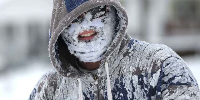 Michael Rainey got his face full of snow after tubing down the hill along Broad Street in Bristol, Tennessee.