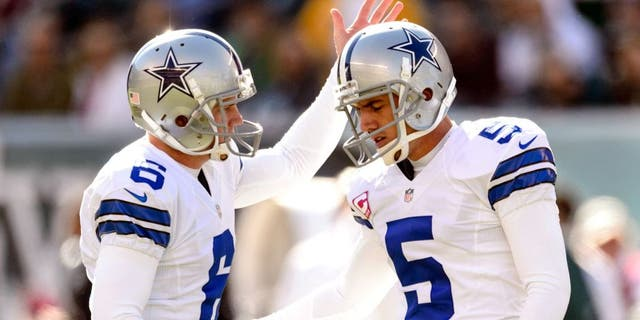 Oct 20, 2013; Philadelphia, PA, USA; Dallas Cowboys place kicker Dan Bailey (5) celebrates kicking a field goal with holder Chris Jones (6) during the second quarter against the Philadelphia Eagles at Lincoln Financial Field. Mandatory Credit: Howard Smith-USA TODAY Sports