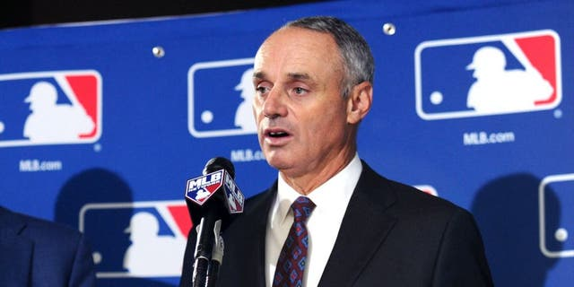 MLB Commissioner Rob Manfred speaks at a news conference in Baltimore, Aug. 14, 2014. (USA Today Sports)