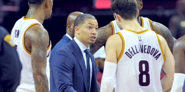 Jan 23, 2016; Cleveland, OH, USA; Cleveland Cavaliers head coach Tyronn Lue (C) huddles with his team during the fourth quarter against the Chicago Bulls at Quicken Loans Arena. The Bulls won 96-83. Mandatory Credit: Ken Blaze-USA TODAY Sports