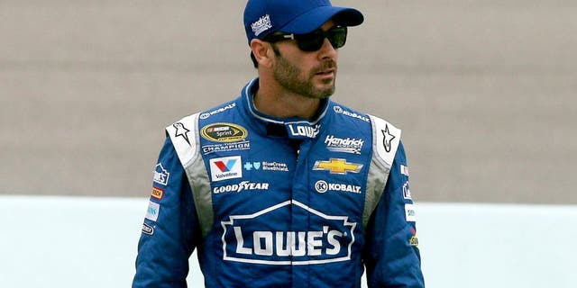 HOMESTEAD, FL - NOVEMBER 21: Jimmie Johnson, driver of the #48 Lowe's Chevrolet, walks on pit road during practice for the NASCAR Sprint Cup Series Ford EcoBoost 400 at Homestead-Miami Speedway on November 21, 2015 in Homestead, Florida. (Photo by Sean Gardner/Getty Images)