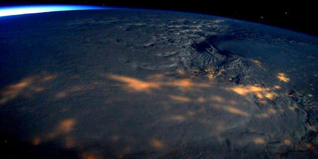 This image made available by NASA via Twitter posted on Saturday, Jan. 23, 2016, by space station commander Scott Kelly, shows a view from the International Space Station of a storm passing over the United States.