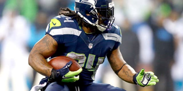 SEATTLE, WA - JANUARY 10: Marshawn Lynch #24 of the Seattle Seahawks runs the ball against the Carolina Panthers during the 2015 NFC Divisional Playoff game at CenturyLink Field on January 10, 2015 in Seattle, Washington. (Photo by Otto Greule Jr/Getty Images)