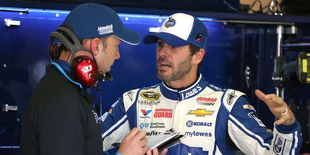 FONTANA, CA - MARCH 21: Jimmie Johnson (right), driver of the #48 Lowe's Chevrolet, speaks with crew chief Chad Knaus during practice for the NASCAR Sprint Cup Series Auto Club 400 at Auto Club Speedway on March 21, 2014 in Fontana, California. (Photo by Robert Laberge/Getty Images)