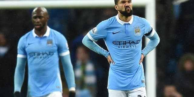 MANCHESTER, ENGLAND - DECEMBER 12: Gael Clichy of Manchester City shows dejection after conceding the first goal to Swansea during the Barclays Premier League match between Manchester City and Swansea City at Etihad Stadium on December 12, 2015 in Manchester, United Kingdom. (Photo by Michael Regan/Getty Images)