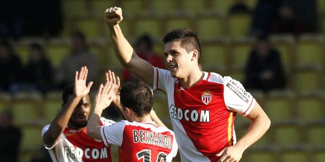 Monaco's Argentinian forward Guido Carrillo (R) celebrates after scoring a goal during the French L1 football match Monaco (ASM) vs Toulouse (TFC) on January 24, 2016 at the Louis II Stadium in Monaco. AFP PHOTO / VALERY HACHE / AFP / VALERY HACHE (Photo credit should read VALERY HACHE/AFP/Getty Images)
