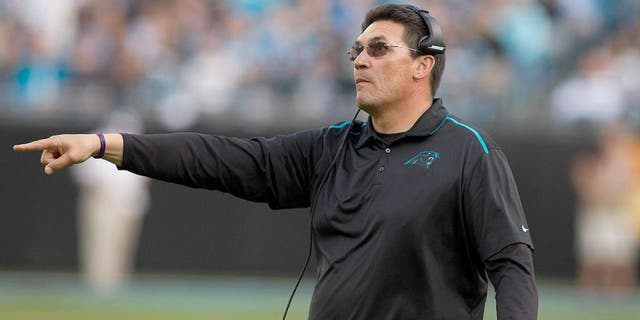 Dec 13, 2015; Charlotte, NC, USA; Carolina Panthers head coach Ron Rivera challenges the play during the third quarter against the Atlanta Falcons at Bank of America Stadium. Panthers defeated the Falcons 38-0. Mandatory Credit: Jeremy Brevard-USA TODAY Sports