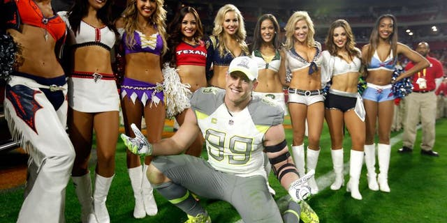 GLENDALE, AZ - JANUARY 25: Team Carter defensive end J.J. Watt #99 of the Houston Texans poses with cheerleaders after the 2015 Pro Bowl at University of Phoenix Stadium on January 25, 2015 in Glendale, Arizona. (Photo by Christian Petersen/Getty Images)