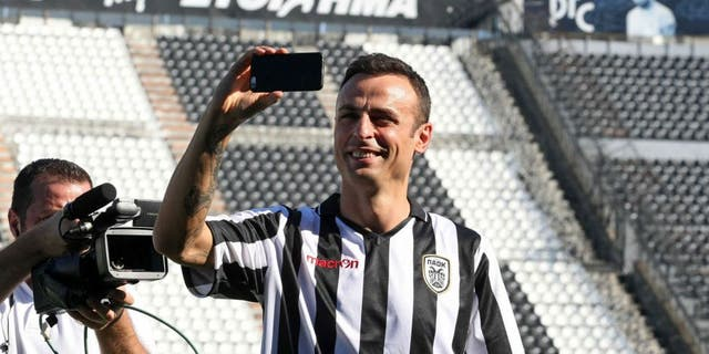 PAOK's new Bulgarian foward Dimitar Berbatov takes a selfie during his presentation at the Toumpa Stadium in Thessaloniki on September 3, 2015. Berbatov has signed to play for one season with PAOK, the Greek Super League club announced on September 3, 2015. AFP PHOTO / SAKIS MITROLIDIS (Photo credit should read SAKIS MITROLIDIS/AFP/Getty Images)