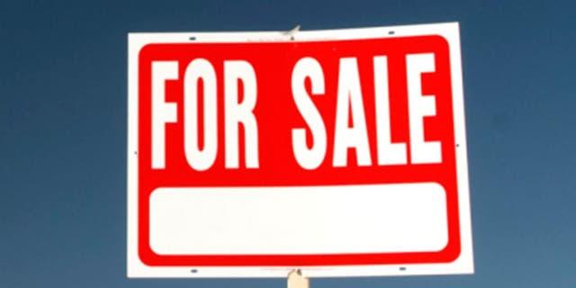 For sale sign in barren landscape.