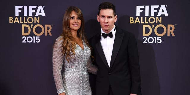 ZURICH, SWITZERLAND - JANUARY 11: Lionel Messi of Argentina and FC Barcelona and his partner Antonella Roccuzzo attend the FIFA Ballon d'Or Gala 2015 at the Kongresshaus on January 11, 2016 in Zurich, Switzerland. (Photo by Matthias Hangst/Getty Images)