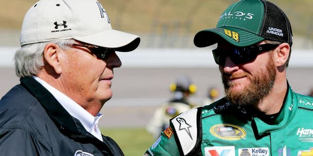 KANSAS CITY, KS - OCTOBER 18: Dale Earnhardt Jr., driver of the #88 Halo 5: Master Chief Chevrolet, talks with Rick Hendrick, owner of Hendrick Motorsports, on the grid prior to the NASCAR Sprint Cup Series Hollywood Casino 400 at Kansas Speedway on October 18, 2015 in Kansas City, Kansas. (Photo by Jerry Markland/Getty Images)