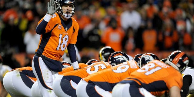 DENVER, CO - JANUARY 17: Peyton Manning #18 of the Denver Broncos calls a play against the Pittsburgh Steelers during the AFC Divisional Playoff Game at Sports Authority Field at Mile High on January 17, 2016 in Denver, Colorado. (Photo by Dustin Bradford/Getty Images)