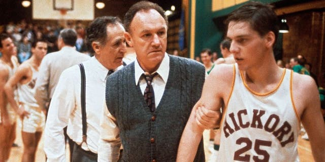 """""""The coach Norman Dale, played by the American actor Gene Hackman, grasps to the arm of a basketball player before a match and rebukes him, in a scene from the engaging dramatic movie Hoosiers. USA, 1986. (Photo by Mondadori Portfolio via Getty Images)"""""""