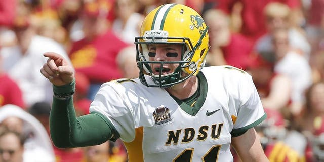 AMES, IA - AUGUST 30: Quarterback Carson Wentz #11 of the North Dakota State Bison calls a play in the second half of play against the Iowa State Cyclones at Jack Trice Stadium on August 30, 2014 in Ames, Iowa. North Dakota State defeated Iowa State 34-14. (Photo by David K Purdy/Getty Images)