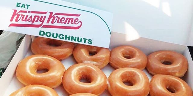 Krispy Kreme is offering a dozen doughnuts for just $1 with the purchase of another dozen doughnuts on Saturday. (Krispy Kreme)