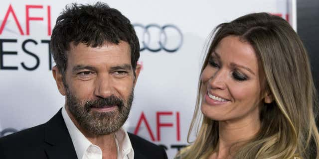 """Antonio Banderas and Nicole Kimpel pose at the screening of """"The 33"""" during AFI Fest 2015 in Hollywood, Calif."""