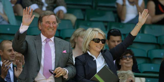 FILE - In this June 28, 2008 file photo, Terry Wogan and Jennifer Saunders are introduced to the crowd from Royal Box on the Centre Court at Wimbledon. Wogan, one of the best-known voices and faces on British television and radio, has died aged 77.