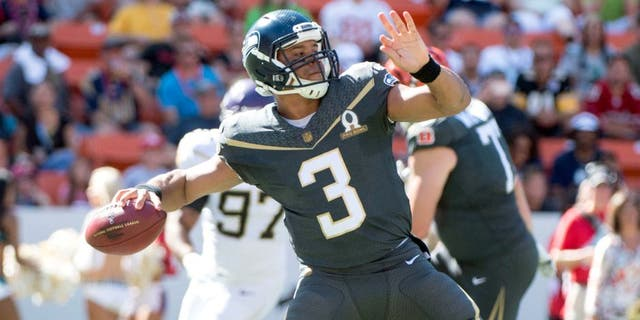 January 31, 2016; Honolulu, HI, USA; Team Irvin quarterback Russell Wilson of the Seattle Seahawks (3) passes the football against Team Rice during the first quarter of the 2016 Pro Bowl game at Aloha Stadium. Mandatory Credit: Kyle Terada-USA TODAY Sports