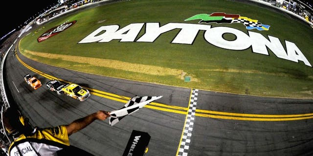 DAYTONA BEACH, FL - JULY 02: David Ragan, driver of the #6 UPS Ford, heads towards the start/finsish line ahead of teammate Matt Kenseth, driver of the #17 Affliction Clothing: Live Fast Ford, to take the checkered flag and win the NASCAR Sprint Cup Series Coke ZERO 400 Powered by Coca-Cola at Daytona International Speedway on July 2, 2011 in Daytona Beach, Florida. (Photo by Mike Ehrmann/Getty Images for NASCAR)