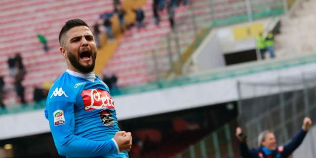 Napoli's Italian forward Lorenzo Insigne celebrates after scoring during the Italian Serie A football match SSC Napoli vs Empoli FC on January 31, 2016 at the San Paolo stadium in Naples. / AFP / CARLO HERMANN (Photo credit should read CARLO HERMANN/AFP/Getty Images)