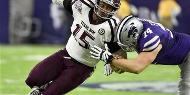 FILE - In this Dec. 28, 2016, file photo, Texas A&M's Myles Garrett (15) tries to get around Kansas State offensive lineman Scott Frantz during the second half of the Texas Bowl NCAA college football game in Houston.The NFL Draft will be held April 27-29, 2017, in Philadelphia. (AP Photo/Eric Christian Smith, File)
