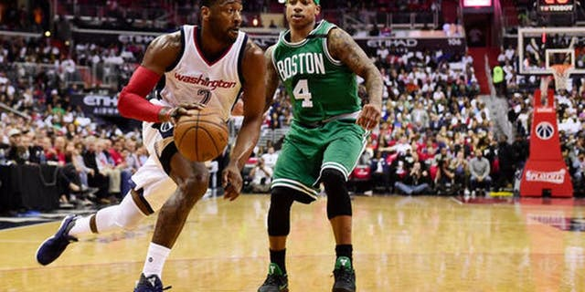 WASHINGTON, DC - MAY 07: John Wall #2 of the Washington Wizards dribbles the ball against Isaiah Thomas #4 of the Boston Celtics in the second quarter in Game Four of the Eastern Conference Semifinals at Verizon Center on May 7, 2017 in Washington, DC. NOTE TO USER: User expressly acknowledges and agrees that, by downloading and or using this photograph, User is consenting to the terms and conditions of the Getty Images License Agreement. (Photo by Patrick McDermott/Getty Images)