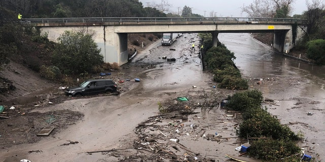 Abadoned cars stuck in flooded water on the freeway after a mudslide in Montecito, California, U.S. in this photo provided by the Santa Barbara County Fire Department, January 9, 2018.