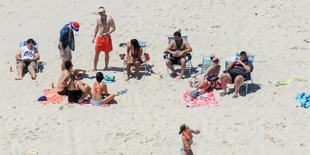 A wider shot of Christie with family and friends.