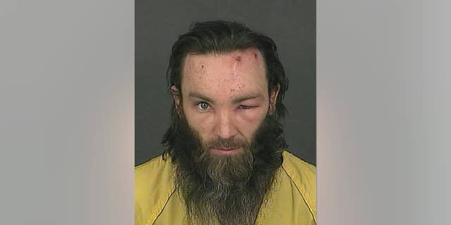 This booking photo released on Feb. 2, 2017 by the Denver Police Department shows homicide suspect Joshua A. Cummings in Denver. Cummings was arrested shortly after the point-blank shooting death of a transit guard in downtown Denver on Tuesday, Jan. 31, 2017. (Denver Police Department via AP)