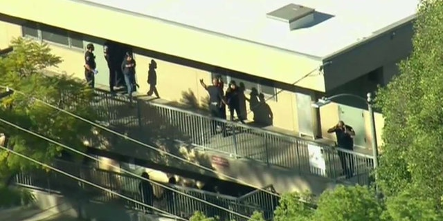 A female student was taken into custody after shots were fired inside a Los Angeles middle school classroom.