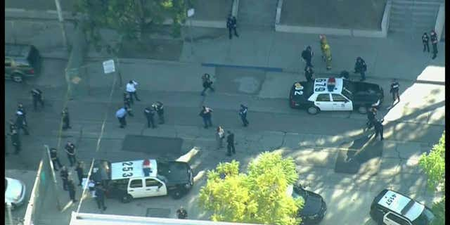 Two 15-year-old students, a male and female, were wounded in the shooting, the LAFD reported.
