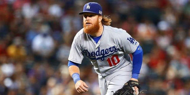 Sep 11, 2015; Phoenix, AZ, USA; Los Angeles Dodgers third baseman Justin Turner against the Arizona Diamondbacks at Chase Field. Mandatory Credit: Mark J. Rebilas-USA TODAY Sports