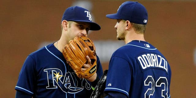 DETROIT, MI - SEPTEMBER 09: Evan Longoria #3 (L) and Jake Odorizzi #23 of the Tampa Bay Rays talk on the pitchers mound during the game against the Detroit Tigers at Comerica Park on September 9, 2015 in Detroit, Michigan. The Rays defeated the Tigers 8-0. (Photo by Mark Cunningham/MLB Photos via Getty Images)