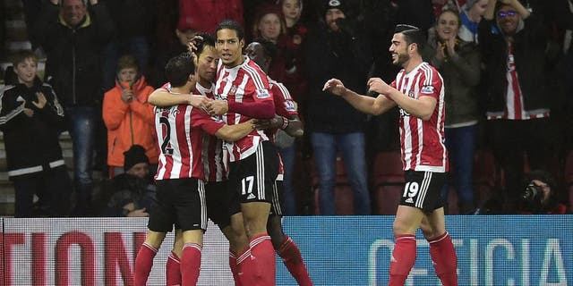 SOUTHAMPTON, ENGLAND - FEBRUARY 06: Maya Yoshida of Southampton (2L) celebrates with team mates as he scores their first goal during the Barclays Premier League match between Southampton and West Ham United at St Mary's Stadium on February 6, 2016 in Southampton, England. (Photo by Alex Broadway/Getty Images)