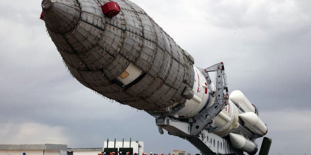 A Russian Proton-M rocket carrying the British telecommunications satellite Inmarsat-5 F3 is mounted on a launch pad at the Russian leased Baikonur cosmodrome on August 25, 2015. The launch of the rocket is scheduled on August 28. AFP PHOTO / STRINGER (Photo credit should read -/AFP/Getty Images)
