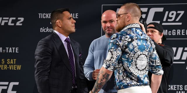 LAS VEGAS, NV - JANUARY 20: Rafael dos Anjos of Brazil (L) and Conor McGregor of Ireland (R) face off during the UFC 197 on-sale press conference event inside MGM Grand Hotel & Casino on January 20, 2016 in Las Vegas, Nevada. (Photo by Jeff Bottari/Zuffa LLC/Zuffa LLC via Getty Images)