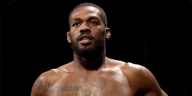 LAS VEGAS, NEVADA - JANUARY 02: UFC light heavyweight champion Jon Jones prepares to step on the scale during the UFC 182 weigh-ins at the MGM Grand Marquee Ballroom on January 2, 2015 in Las Vegas, Nevada. (Photo by Brandon Magnus/Zuffa LLC/Zuffa LLC via Getty Images)