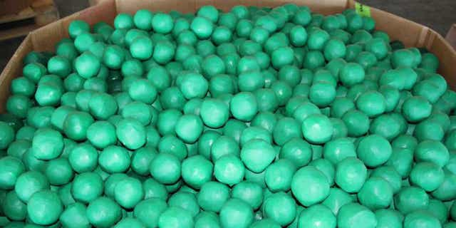 Lime-shaped bundles containing 3,947 pounds of marijuana seized by CBP officers at Pharr International Bridge