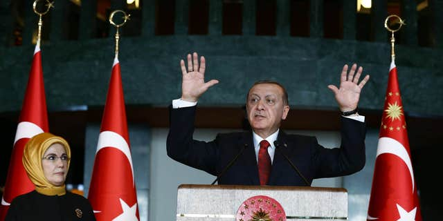 Feb. 9, 2016: Turkish President Recep Tayyip Erdogan, right, addresses a reception next to his wife Emine Erdogan at his palace in Ankara, Turkey.
