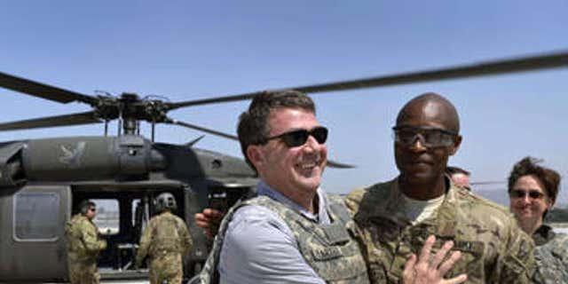 Former Defense Secretary Ash Carter with Maj. Gen. Ronald Lewis
