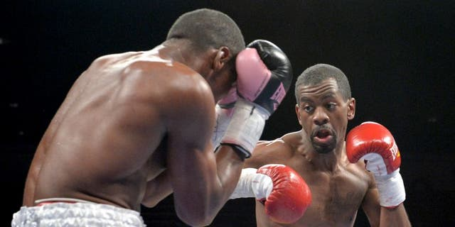 Antonio Sanchez (L) of Bayamon, Puerto Rico, defends against Jamel Herring (R) of Coram, NY, USA, during their lightweight preliminary match at the DC Armory on January 25, 2014 in Washington, DC, ahead of the IBF Jr. welterweight title match between Lamont Peterson and Dierry Jean. Herring won a 6-round split decision. AFP PHOTO / Nicholas KAMM (Photo credit should read NICHOLAS KAMM/AFP/Getty Images)